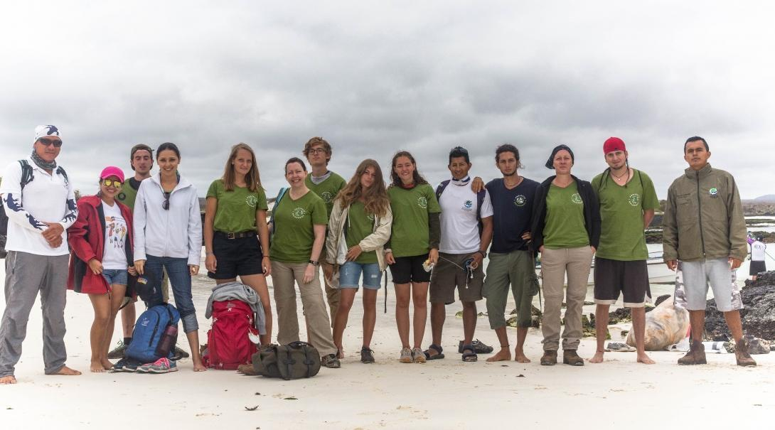 A picture of a group of volunteers from Projects Abroad assisting with a beach clean up during their conservation volunteering in the Galapagos Islands.
